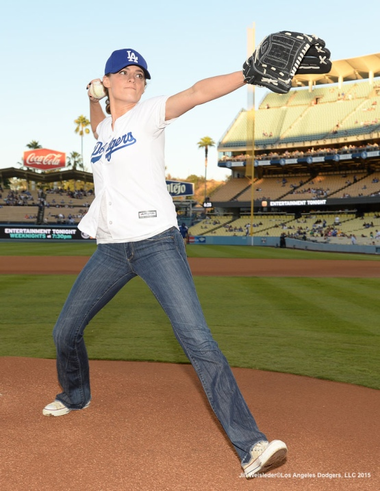 "Actress and star of the TV show ""Castle"" Stana Katic warms up for the ceremonial first pitch prior to the game against the Pittsburgh Pirates. Jill Weisleder/LA Dodgers"