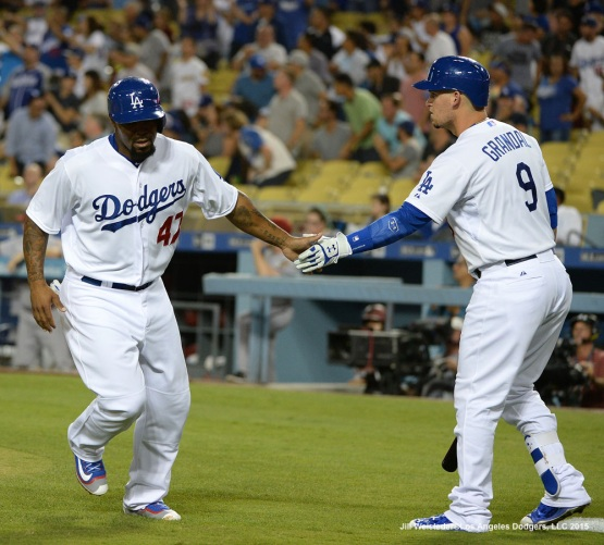 Yasmani Grandal congratulates Howie Kendrick after scoring in a run. Jill Weisleder/LA Dodgers