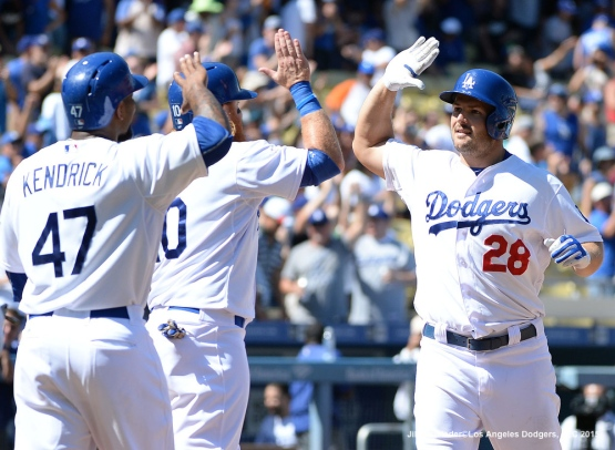 Chris Heisey is congratulated by teammates as he crosses home plate after getting a grand slam. Jill Weisleder/LA Dodgers