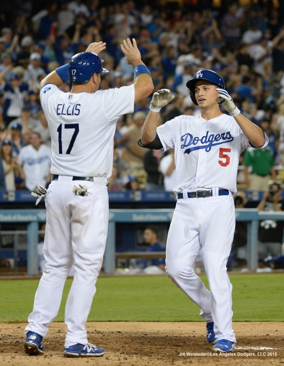 A.J. Ellis greets Corey Seager at home plate after getting a two-run home run. Jill Weisleder/LA Dodgers