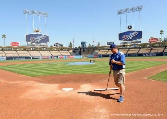 The Dodger grounds crew prepares the field prior to the game against the Arizona Diamondbacks. Jill Weisleder/LA Dodgers