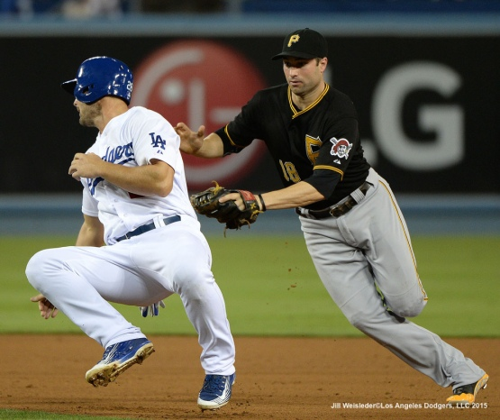 Pittsburgh Pirates second basemen Neil Walker applies the tag to Justin Ruggiano during a run-down. Jill Weisleder/LA Dodgers