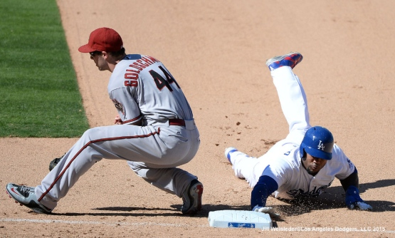 Carl Crawford reaches safely back to first base. Jill Weisleder/LA Dodgers