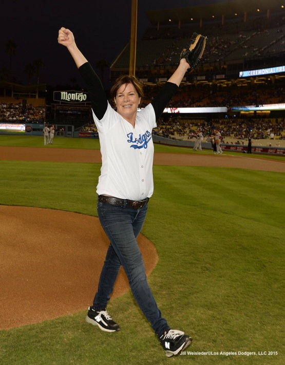 Actress Marcia Gay Harden smiles after the ceremonial first pitch prior to the start of the game against the Arizona Diamondbacks. Jill Weisleder/LA Dodgers