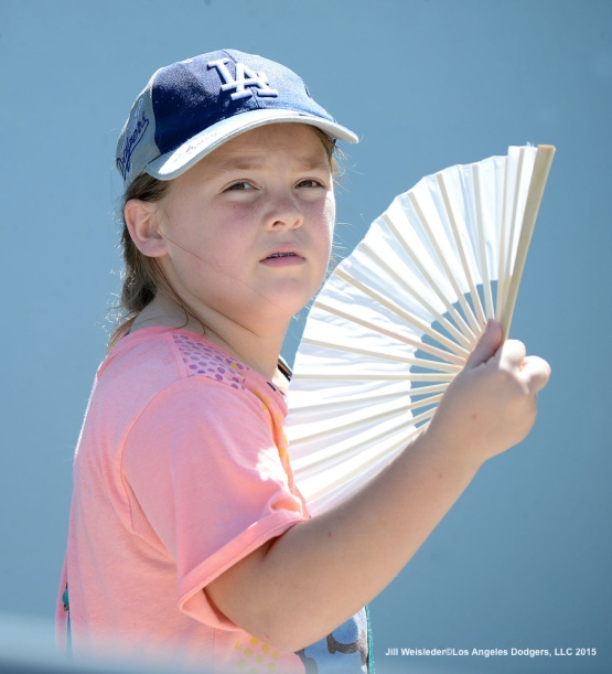 A young Dodger fan tries to cool off during today's afternoon game. Jill Weisleder/LA Dodgers