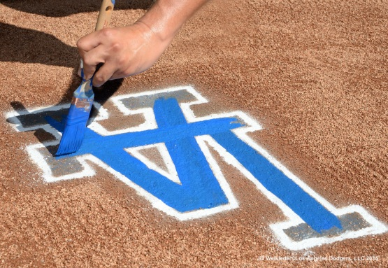 A Dodger grounds crew prepares the LA logo on the mound. Jill Weisleder/LA Dodgers