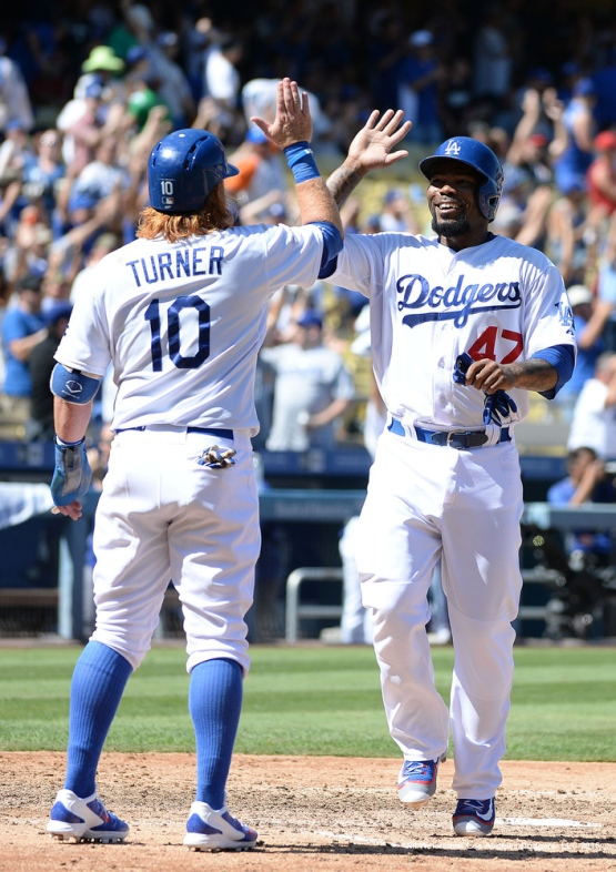 Justin Turner high-fives Howie Kendrick as he crosses home plate. Jill Weisleder/LA Dodgers
