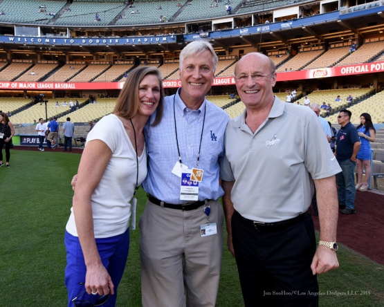 Kim Walter, Mark Walter, Stan Kasten--NLDS-Game One-Los Angeles Dodgers vs New York Mets Friday, October 9, 2015 at Dodger Stadium in Los Angeles, California.  Photo by Jon SooHoo /©Los Angeles Dodgers,LLC 2015