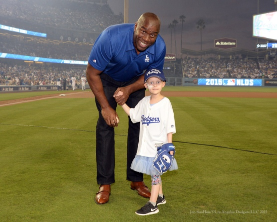 Magic Johnson with ceremonial first pitch honoree Ella Annear--NLDS-Game One-Los Angeles Dodgers vs New York Mets Friday, October 9, 2015 at Dodger Stadium in Los Angeles, California.  Photo by Jon SooHoo /©Los Angeles Dodgers,LLC 2015