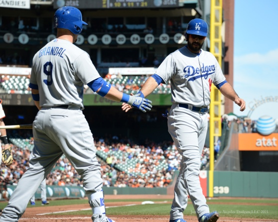 Yasmani Grandal greets Andre Ethier after scoring--Los Angeles Dodgers vs San Francisco Giants Wednesday October 1, 2015 at AT&T Park in San Francisco, California.  Photo by Jon SooHoo /©Los Angeles Dodgers,LLC 2015