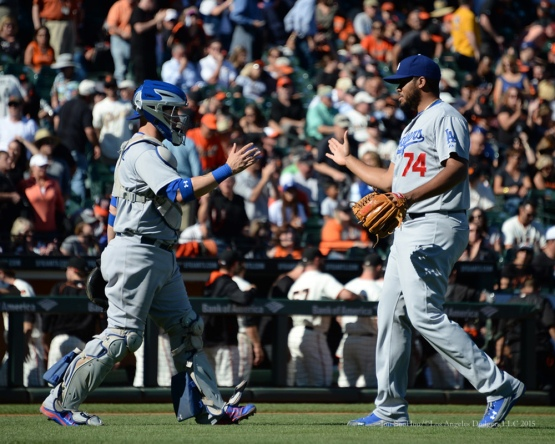 Yasmani Grandal greets Kenley Jansen after defeating the Giants 3-2-- Los Angeles Dodgers vs San Francisco Giants Wednesday October 1, 2015 at AT&T Park in San Francisco, California.  Photo by Jon SooHoo /©Los Angeles Dodgers,LLC 2015