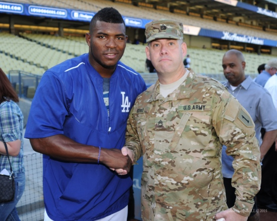 Yasiel Puig with US Army Sergeant First Class, Shawn Boiko--Los Angeles Dodgers vs San Diego Padres Saturday, October 3, 2015 at Dodger Stadium in Los Angeles, California.  Photo by Jon SooHoo /©Los Angeles Dodgers,LLC 2015
