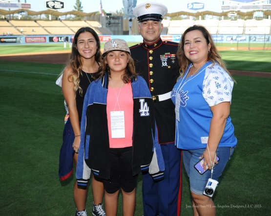 Military Hero of the Game, Marine Corp Sergeant, Paul Roche and family--Los Angeles Dodgers vs San Diego Padres Saturday, October 3, 2015 at Dodger Stadium in Los Angeles, California.  Photo by Jon SooHoo /©Los Angeles Dodgers,LLC 2015