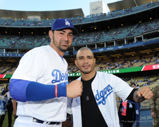 Adrian Gonzalez with boxer Miguel Cotto--Los Angeles Dodgers vs San Diego Padres Saturday, October 3, 2015 at Dodger Stadium in Los Angeles, California.  Photo by Jon SooHoo /©Los Angeles Dodgers,LLC 2015
