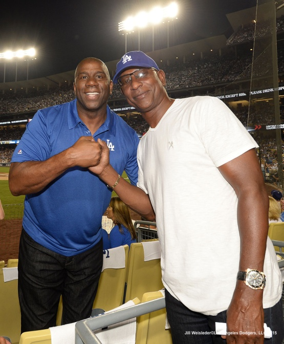 Magic Johnson and Eric Dickerson pose for a photo during the game. Jill Weisleder/Dodgers