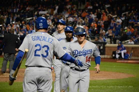 Adrian Gonzalez greets Kike Hernandez, Howie Kendrick and Corey Seager after scoring--2015 NLDS-Game Three-Los Angeles Dodgers vs New York Mets Monday, October 12, 2015 at Citi Field in Flushing, New York.  Photo by Jon SooHoo /©Los Angeles Dodgers,LLC 2015