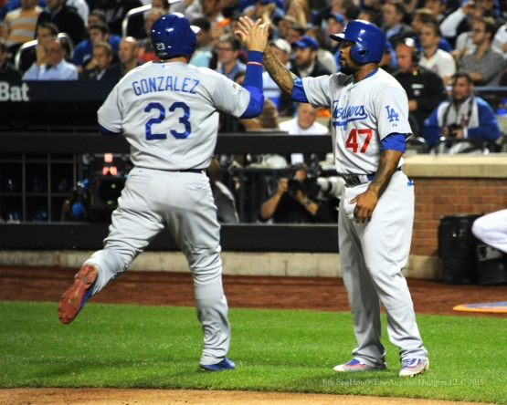 Adrian Gonzalez is greeted by Howie Kendrick after scoring--2015 NLDS-Game Four-Los Angeles Dodgers vs New York Mets Tuesday, October 13, 2015 at Citi Field in Flushing, New York.  Photo by Jon SooHoo /©Los Angeles Dodgers,LLC 2015