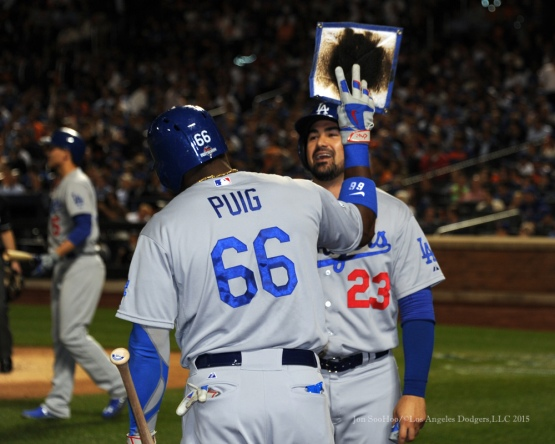 Yasiel Puig and Adrian Gonzalez--2015 NLDS-Game Four-Los Angeles Dodgers vs New York Mets Tuesday, October 13, 2015 at Citi Field in Flushing, New York.  Photo by Jon SooHoo /©Los Angeles Dodgers,LLC 2015