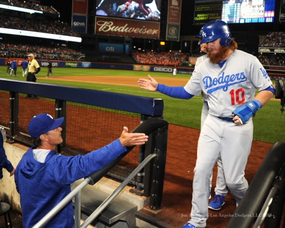 Justin Turner is greeted in the dugout--2015 NLDS-Game Four-Los Angeles Dodgers vs New York Mets Tuesday, October 13, 2015 at Citi Field in Flushing, New York.  Photo by Jon SooHoo /©Los Angeles Dodgers,LLC 2015
