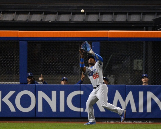 Yasiel Puig runs down fly ball--2015 NLDS-Game Four-Los Angeles Dodgers vs New York Mets Tuesday, October 13, 2015 at Citi Field in Flushing, New York.  Photo by Jon SooHoo /©Los Angeles Dodgers,LLC 2015