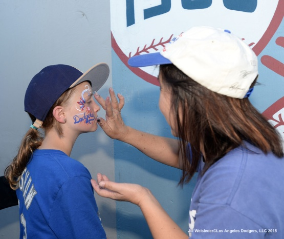 A young Dodger fan gets her face painted. Jill Weisleder/Dodgers