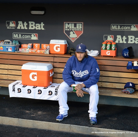 Starting pitcher Clayton Kershaw sits in the dugout prior to the start of the game. Jill Weisleder/Dodgers