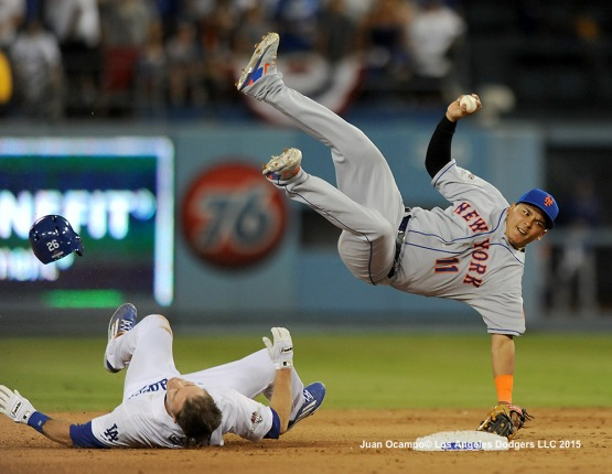 Chase Utley breaks up the double-play attempt by the Mets' Ruben Tejada.