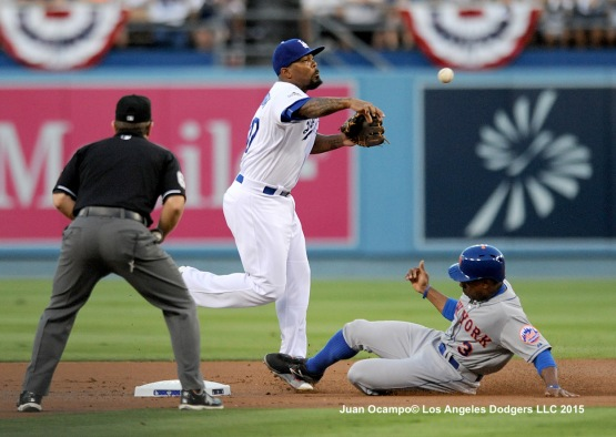 Howie Kendrick forces the Mets' Curtis Granderson out at second base.