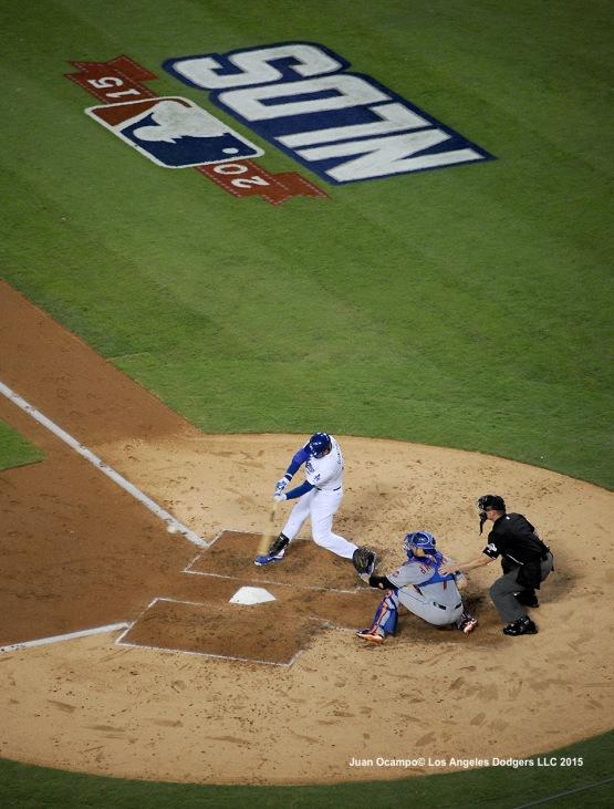 Adrian Gonzalez takes a swing.