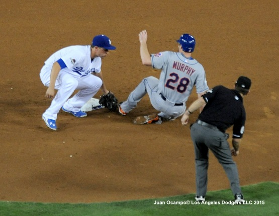 Corey Seager tags out the Mets' Daniel Murphy at second base.