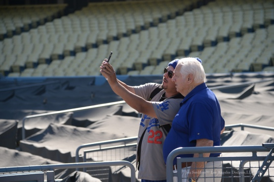 Tom Lasorda poses with fan during Los Angeles Dodgers Veterans Day Batting Practice Wednesday, November 18, 2015 at Dodger Stadium in Los Angeles,California. Photo by Jon SooHoo/©Los Angeles Dodgers,LLC 2015