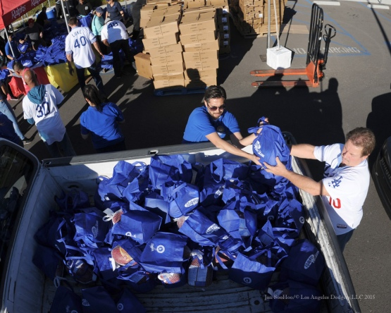 Ron Cey loads truck with bags of goods during the Los Angeles Dodgers Thanksgiving Turkey Giveaway Thursday, November 19, 2015 in Los Angeles,California. Photo by Jon SooHoo/©Los Angeles Dodgers,LLC 2015