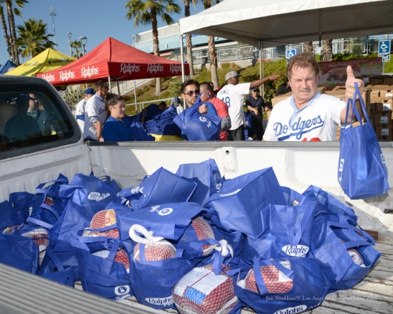 Ron Cey loads the back of a pick up truck with goods during the Los Angeles Dodgers Thanksgiving Turkey Giveaway Thursday, November 19, 2015 in Los Angeles,California. Photo by Jon SooHoo/©Los Angeles Dodgers,LLC 2015