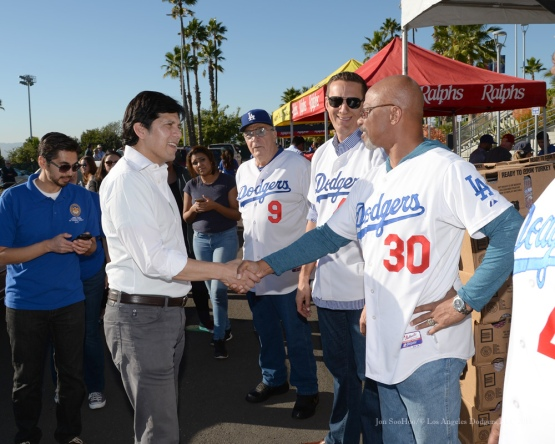 Senator Kevin DeLeon is greeted by Derrel Thomas, Matt Luke and Al Ferrara during the Los Angeles Dodgers Thanksgiving Turkey Giveaway Thursday, November 19, 2015 in Los Angeles,California. Photo by Jon SooHoo/©Los Angeles Dodgers,LLC 2015