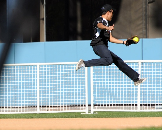 Yancey Arias with catch--Adrian Gonzalez's Bat4Hope Softball Game  Saturday, November 7, 2015 at Dodger Stadium.  Photo by Jon SooHoo/©Los Angeles Dodgers,LLC 2015