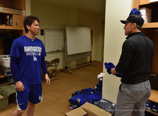 Los Angeles Dodgers Kenta Maeda meets Chase Utley during reporting day for pitchers and catchers Friday, February 19, 2016 at Camelback Ranch-Glendale in Phoenix, Arizona