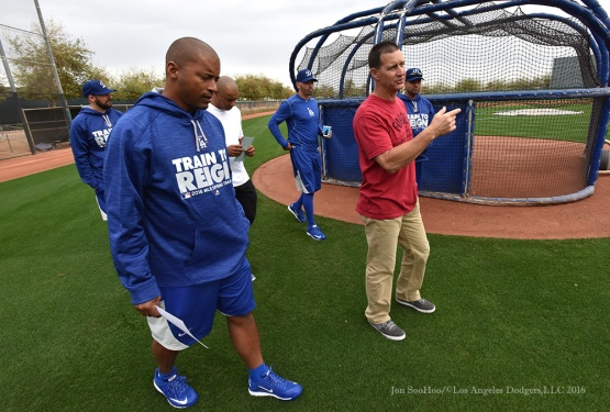 Los Angeles Dodgers coaches George Lombard and Rob Flippo walk the fields during reporting day for pitchers and catchers Friday, February 19, 2016 at Camelback Ranch-Glendale in Phoenix, Arizona