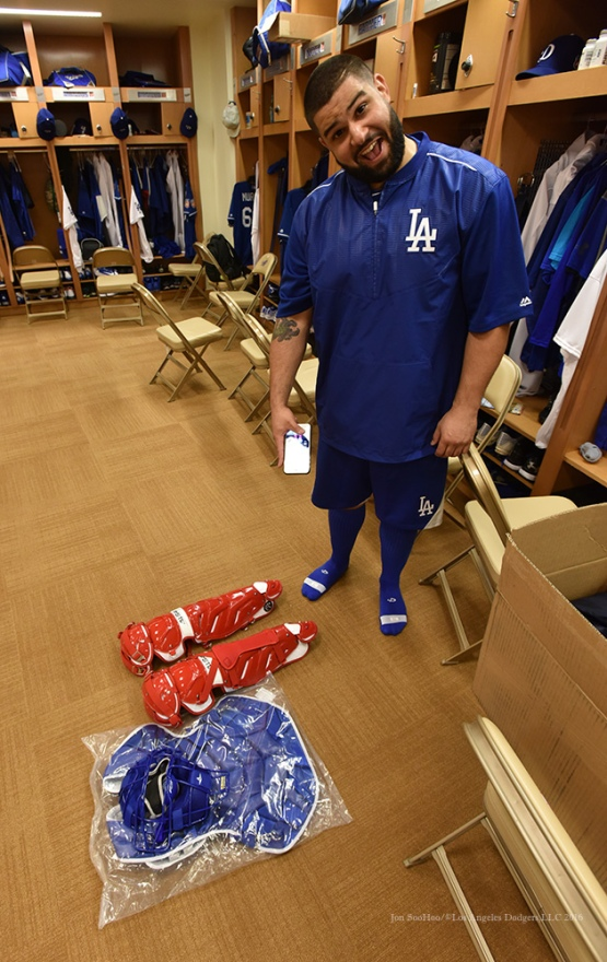 Los Angeles Dodgers catcher Shawn Zarraga shows his red gear to be returned during reporting day for pitchers and catchers Friday, February 19, 2016 at Camelback Ranch-Glendale in Phoenix, Arizona