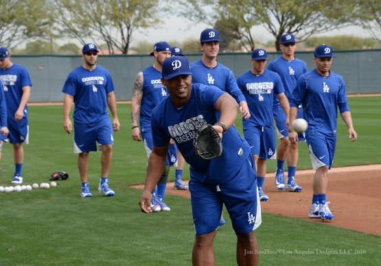 Los Angeles Dodgers coach George Lombard catches the ball during reporting day for pitchers and catchers Friday, February 19, 2016 at Camelback Ranch-Glendale in Phoenix, Arizona