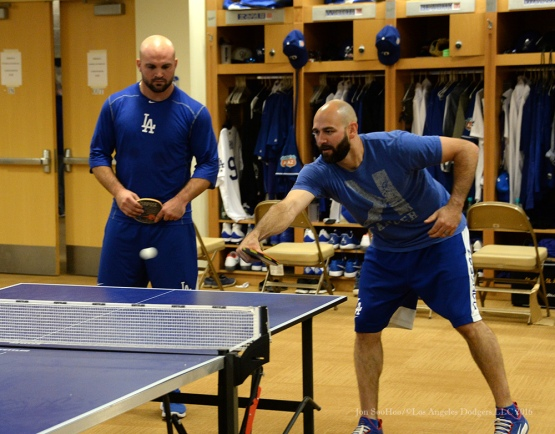 Los Angeles Dodgers Chris Hatcher hits the ball ball as teammate Adam Liberatore watches during reporting day for pitchers and catchers Friday, February 19, 2016 at Camelback Ranch-Glendale in Phoenix, Arizona