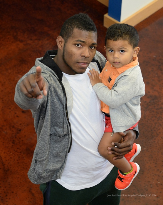 Los Angeles Dodgers Yasiel Puig and son Diego pose during reporting day for pitchers and catchers Friday, February 19, 2016 at Camelback Ranch-Glendale in Phoenix, Arizona