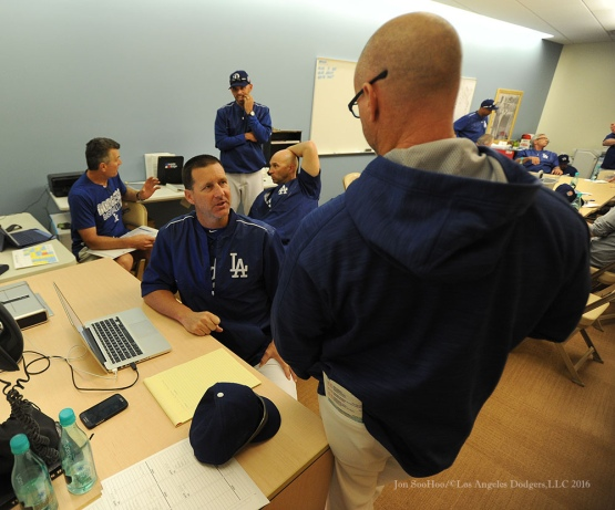 Los Angeles Dodgers coach Rob Flippo talks with Travis Barbary during pitchers and catchers workout Sunday, February 21, 2016 at Camelback Ranch-Glendale in Phoenix, Arizona. Photo by Jon SooHoo/©Los Angeles Dodgers,LLC 2016