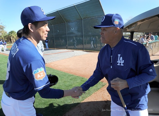Los Angeles Dodgers Kenta Maeda meets Maury Wills during pitchers and catchers workout Sunday, February 21, 2016 at Camelback Ranch-Glendale in Phoenix, Arizona. Photo by Jon SooHoo/©Los Angeles Dodgers,LLC 2016