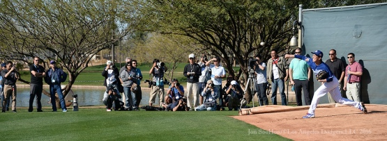 Los Angeles Dodgers Kenta Maeda, followed by a few media members, throws a bullpen session during pitchers and catchers workout Sunday, February 21, 2016 at Camelback Ranch-Glendale in Phoenix, Arizona. Photo by Jon SooHoo/©Los Angeles Dodgers,LLC 2016