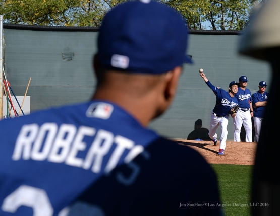 Los Angeles Dodgers Manager Dave Roberts watches pitcher Kenta Maeda pitch during pitchers and catchers workout Sunday, February 21, 2016 at Camelback Ranch-Glendale in Phoenix, Arizona. Photo by Jon SooHoo/©Los Angeles Dodgers,LLC 2016