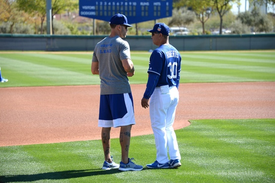 Los Angeles Dodgers Director of Player Development Gabe Kapler and Manager Dave Roberts talk during pitchers and catchers workout Sunday, February 21, 2016 at Camelback Ranch-Glendale in Phoenix, Arizona. Photo by Jon SooHoo/©Los Angeles Dodgers,LLC 2016