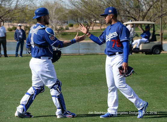 Los Angeles Dodgers Yasmani Grandal  and Julio Urias shake hands during workout Tuesday, February 23, 2016 at Camelback Ranch-Glendale in Phoenix, Arizona. Photo by Jon SooHoo/©Los Angeles Dodgers,LLC 2016