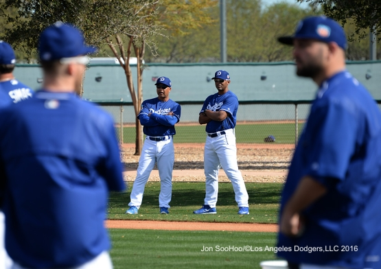 Los Angeles Dodgers Dave Roberts and George Lombard talk during workout Tuesday, February 23, 2016 at Camelback Ranch-Glendale in Phoenix, Arizona. Photo by Jon SooHoo/©Los Angeles Dodgers,LLC 2016