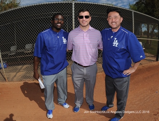Los Angeles Dodgers Travis Smith, Andrew Friedman and Possum Nakajima pose during workout Tuesday, February 23, 2016 at Camelback Ranch-Glendale in Phoenix, Arizona. Photo by Jon SooHoo/©Los Angeles Dodgers,LLC 2016