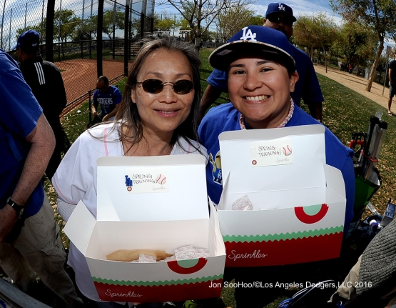 Los Angeles Dodgers fans show off their cookies during workout Tuesday, February 23, 2016 at Camelback Ranch-Glendale in Phoenix, Arizona. Photo by Jon SooHoo/©Los Angeles Dodgers,LLC 2016